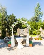 Wedding archway with flowers arranged in park  for a wedding ceremony Stock Photos