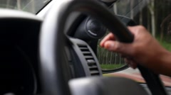 Driver's Hands on Steering Wheel Inside of a Car Stock Footage