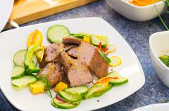 Delicious flank steak cuts cooked to perfection, mixed with reddish, zucchini Stock Photos