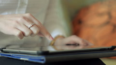 Close-Up of a Young Girl Holding a Tablet on Lap Stock Footage