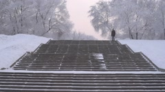 Woman running down the stairs Stock Footage