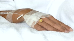 IV solution in a patients hand Stock Footage