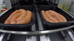 Raw Sausages in Vacuum and Gas Flush Tray Sealer. - stock footage