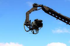 Camera on crane shooting Stock Photos