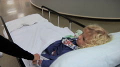 Mother Walking With Little Boy In Hospital - stock footage