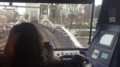 Conductor driving metro train crossing iron bridge over la seine Stock Footage