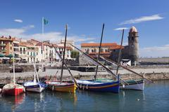 Traditional fishing boats at the port, fortress church Notre Dame des Anges, Stock Photos