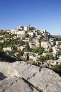 Hilltop village of Gordes with castle and church, Provence, Provence-Alpes-Cote - stock photo