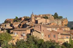 Sunrise over hilltop village of Roussillon, rocks of ochre, Provence, Stock Photos