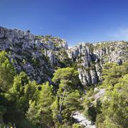 People hiking through rocky landscape of les Calanques, National Park, Cassis, Stock Photos