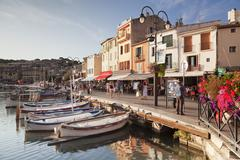 Fishing boats at the harbour, restautants and street cafes on the promenade, Stock Photos