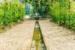 Artificial waterfall in botanic garden Stock Photos