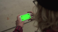Stock Video Footage of Close Up Man Holding Iphone with Green Screen For Custom Content