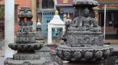 Buddha statues and the boy in red hoodie Stock Footage
