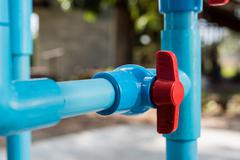 Water valve connects to PVC pipe. - stock photo