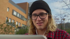 Young Happy College Student Working On Laptop Outside While Laughing Stock Footage