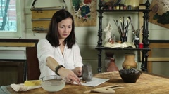 Stock Video Footage of Artisan woman shaping clay sculpture