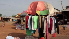 Africa village market clothes shop Stock Footage