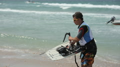 Man With A kiteboard on The sea Shore Stock Footage