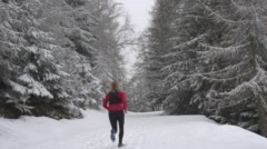 Women Running Through Snowy Forest. Stock Footage