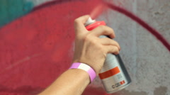 Man Painting Graffiti in Red Paint on The Wall Stock Footage