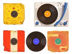 Old turntable player with record albums isolated on white - stock photo