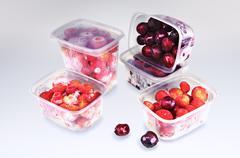Frozen cherries and strawberries - stock photo