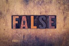 False Concept Wooden Letterpress Type Stock Photos