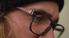 Close Up Shot of Hipster Man With Glasses Looking At Phone Stock Footage