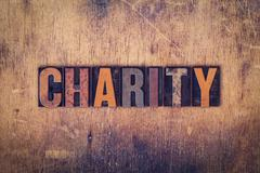 Charity Concept Wooden Letterpress Type Stock Photos