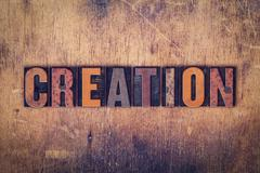 Creation Concept Wooden Letterpress Type - stock photo