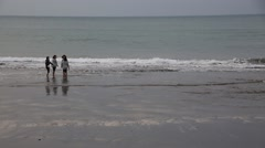 Girls playing on the ocean beach - stock footage