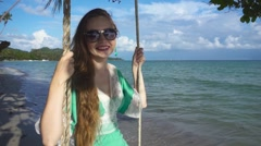 Young Woman Teeters on the Sea Background. Slow Motion Stock Footage