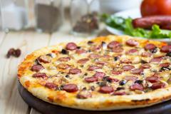 Homemade Pizza with hunter sausages - stock photo