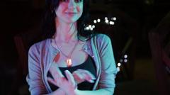 Pretty  girl walks on a night club Stock Footage