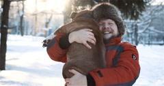 Man hugs his dog - stock footage
