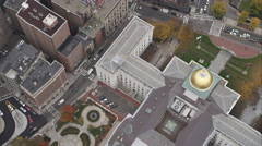 Over downtown Boston and Massachusetts State House, looking down. Shot in Stock Footage