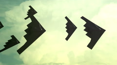 Stealth bombers in formation in clouds cloudy Stock Footage