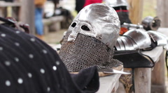 Male actors putting on plate armour, reenactment of medieval history events - stock footage