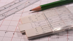 Calculations using an old slide rule. - stock footage