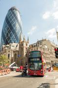 LONDON - MAY 10, 2015. Double Decker bus in city business district. Public tr - stock photo
