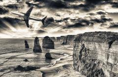 Airplane over Twelve Apostles, Australia. Travel concept Stock Photos