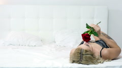 Sexy lady on the white bed Stock Footage