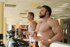 Two sportsmen in gym. Stock Photos