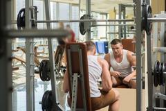 Young bodybuilder in gym. Stock Photos