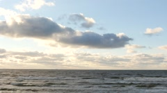 Dolly shot of sea waters with clouds and shining sun time lapse Stock Footage