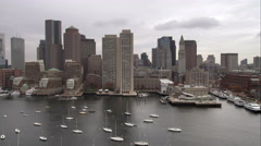 Over Boston Harbor, from downtown to north end of waterfront. Shot in November - stock footage