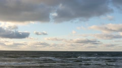 panoramic dolly shot of winter sea with clouds time lapse - stock footage