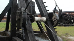 Medieval wooden catapult exhibits at open air history museum, military equipment Stock Footage