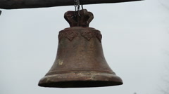 Antique rusty bronze bell ringing during church service, history museum exhibit Stock Footage